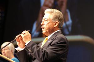 Primary view of object titled '[Gonzalo Barrientos adjusting microphone at podium]'.