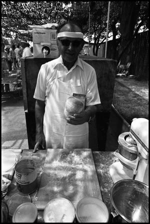 Primary view of object titled '[The Grobes Serving Sausage at the Texas Folklife Festival]'.