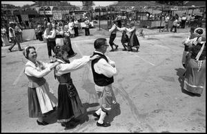Primary view of object titled '[Gulf Coast Scandinavian Folk Dancers Performing at the Texas Folklife Festival]'.