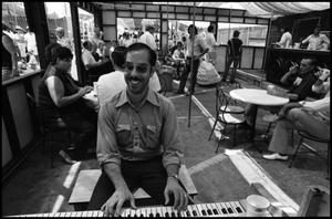Primary view of object titled '[Piano Player at the Texas Folklife Festival]'.