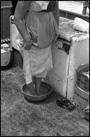 Primary view of object titled '[Ice Bath at the Texas Folklife Festival]'.