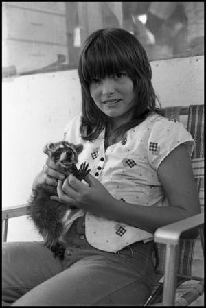 Primary view of object titled '[Child Holding Raccoon]'.