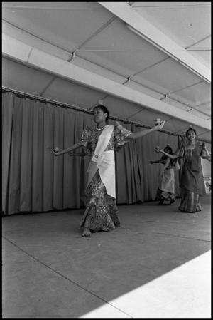 Primary view of object titled '[Bayanihan Dancer Performing the Candle Dance at the Texas Folklife Festival]'.
