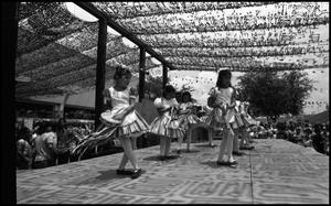 Primary view of object titled '[Ballet Folklorico de San Antonio dancers at the Texas Folklife Festival]'.