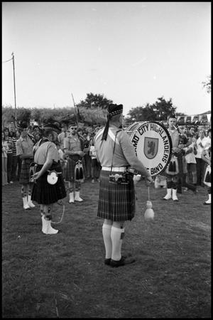 Primary view of object titled '[Alamo City Highlanders Performing at the Texas Folklife Festival]'.
