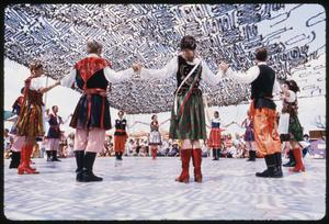 Primary view of object titled '[Austin Polish Folk Dancers and Krakowiak Dancers from San Antonio at the Texas Folklife Festival  - August 1975]'.