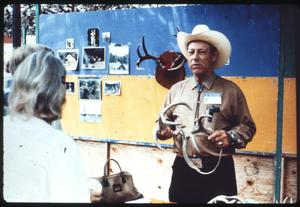 Primary view of object titled '[Bob Ramsey Performing at the Texas Folklife Festival]'.