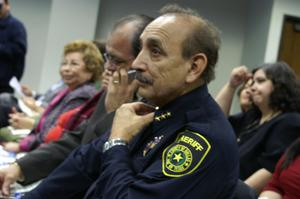 Primary view of object titled '[Officer of Dallas County Sheriff's Office listening to speakers]'.