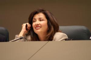 Primary view of object titled '[Elba Garcia smiling during meeting]'.