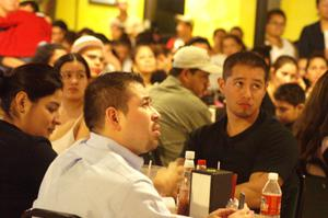 Primary view of object titled '[Individuals react to a speaker at the El Salvador Restaurant]'.