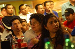 Primary view of object titled '[Immigrants Gather at the El Salvador Restaurant]'.