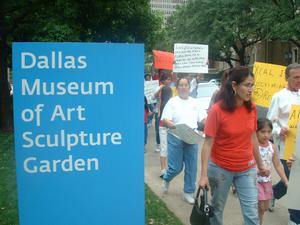 Primary view of object titled '[Protesters march past the Dallas Museum of Art Sculpture Garden]'.