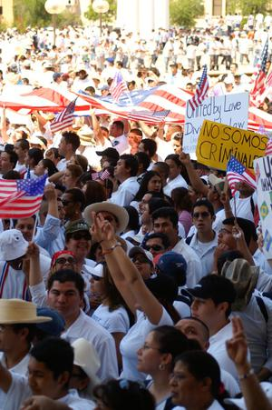 Primary view of object titled '[Large gathering of immigration protesters holding signs and flags]'.