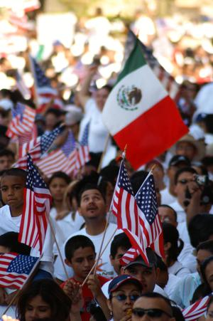 Primary view of object titled '[Immigration protesters wave American and Mexican flags]'.