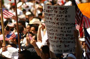 Primary view of object titled '[Protester holds sign]'.