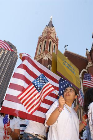 Primary view of object titled '[Protesters and American flags]'.