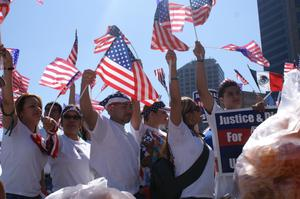 Primary view of object titled '[Immigration protesters carry flags and signs]'.