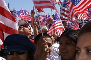 Primary view of object titled '[Immigration protesters wave American flags]'.
