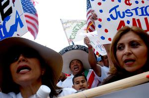 Primary view of object titled '[Immigration protesters, signs, and American flags]'.