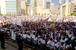 Primary view of object titled '[Large Crowd Gathers in Downtown Dallas for Immigration Protest]'.