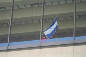 Primary view of object titled '[Honduran Flag Is Displayed in a Window]'.