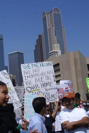 "Primary view of object titled '[Sign reads, in part, ""We Mexicans are not immagrents we are on our home...']'."