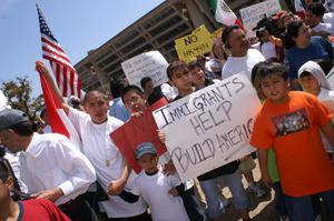 Primary view of object titled '[Protesters hold up signs outside Dallas City Hall]'.