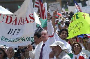Primary view of object titled '[Protesters carry signs]'.