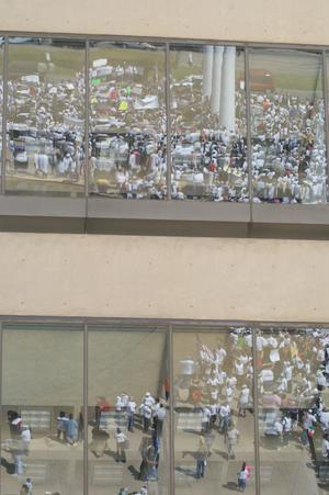 Primary view of object titled '[Protesters reflected in windows]'.
