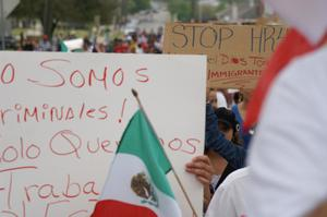 Primary view of object titled '[Close-up on handwritten signs and Mexican flag]'.