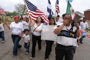 Primary view of object titled '[Group of protesters with flags, sign, and megaphone]'.