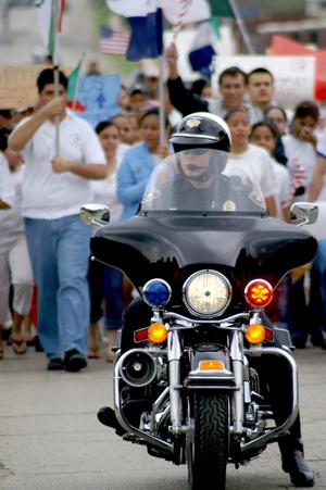 [Close-up view of police officer on motorcycle]