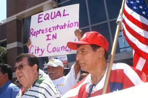 "[Protesters with sign, ""Equal Representation in City Council""]"