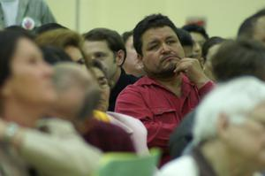 Primary view of object titled '[Hispanic Man Looks at Speakers]'.
