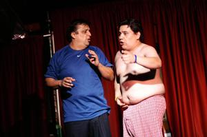 Primary view of object titled '[Half naked man talks to another man during a skit]'.