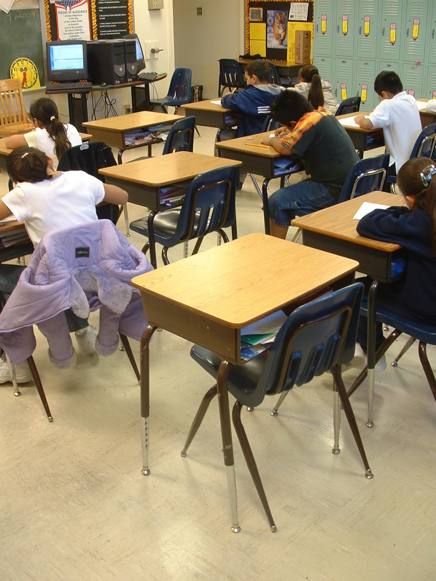 Empty Desks Show The Number Of Absent Students In A