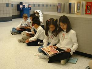 Primary view of object titled '[Students read to each other at Seminary Hills Elementary]'.