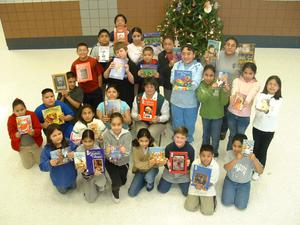 Primary view of object titled '[Students and their teacher pose with the books at Seminary Hills Elementary]'.