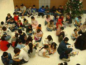 Primary view of object titled '[Students read books at Seminary Hills Elementary]'.