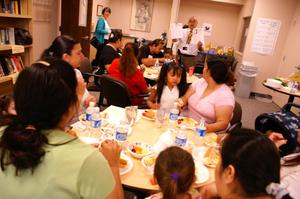 Primary view of object titled '[Families eat lunch during an Early Education Program class]'.