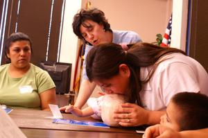 Primary view of object titled '[First aid class is taught as part of the Early Education Program]'.