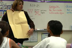 Primary view of object titled '[Nancy Jimenez conducts a third grade class at Crockett Elementary]'.