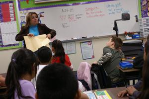 Primary view of object titled '[Nancy Jimenez teaches a third grade class in Crockett Elementary]'.