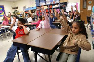 Primary view of object titled '[Students respond during a third grade class in Crockett Elementary]'.