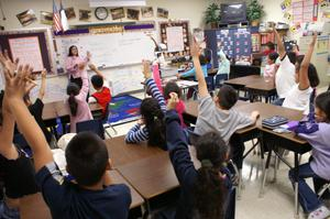 Primary view of object titled '[Delisse Hardy leads a third grade class at Crockett Elementary]'.