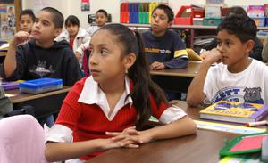 Primary view of object titled '[Students listen to their teacher at Crockett Elementary]'.