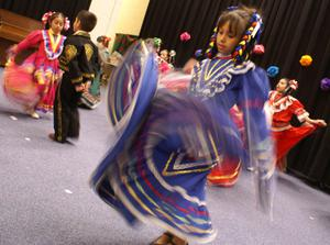 Primary view of object titled '[Children perform a Mexican folk dance]'.