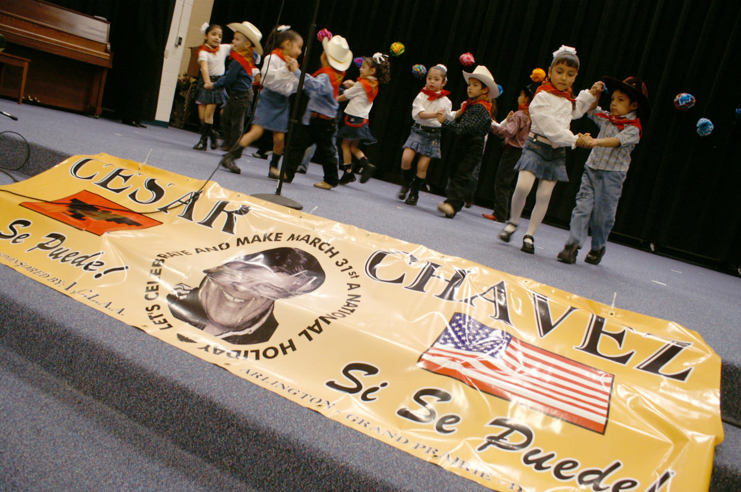 [Group of young dancers perform behind banner for Cesar Chavez Day]                                                                                                      [Sequence #]: 1 of 1