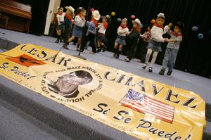 Primary view of object titled '[Group of young dancers perform behind banner for Cesar Chavez Day]'.