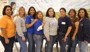 Primary view of object titled '[Administrators pose in front of a mural at the Cesar Chavez School]'.